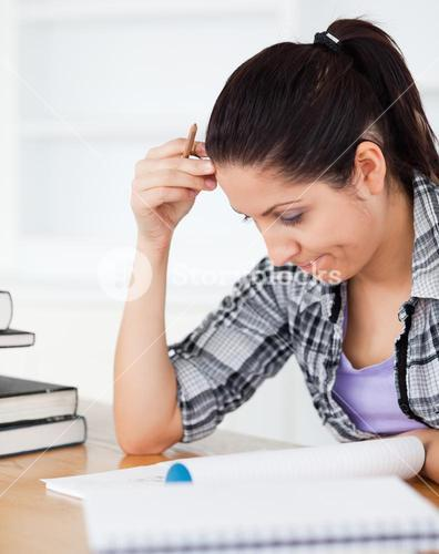 Young student focusing on homework