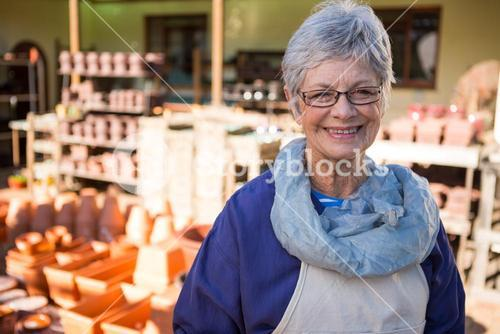 Female potter standing in pottery workshop