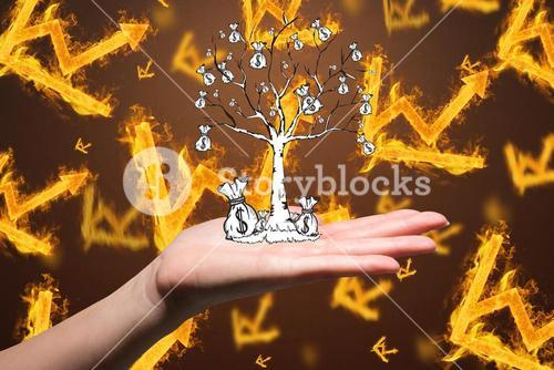 hand holding money tree over burning graph background