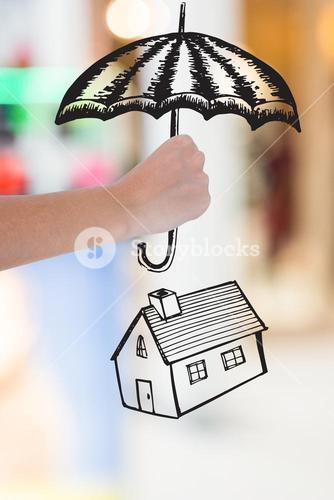 hand holding umbrella graphic above house graphic