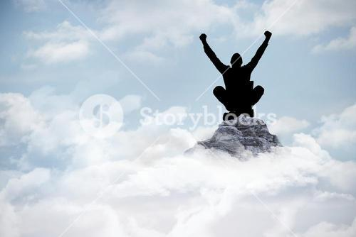silhouette of cheering person on mountain