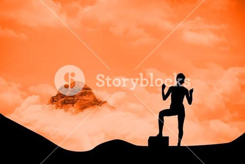 silhouette of cheering person with mountain background