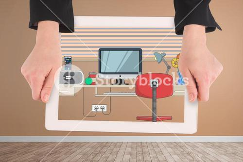 hands holding tablet computer with graphics