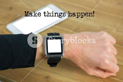 hand with smartwatch and desk background
