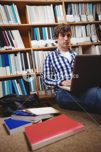 Student using laptop in library
