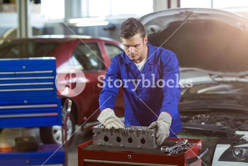 Mechanic checking a car parts