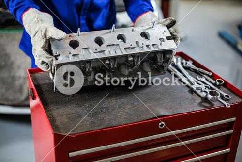 Hands of mechanic checking car parts