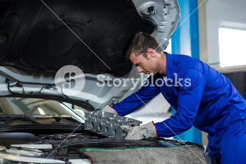 Mechanic installing car parts