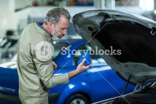Mechanic using cleaning cloth