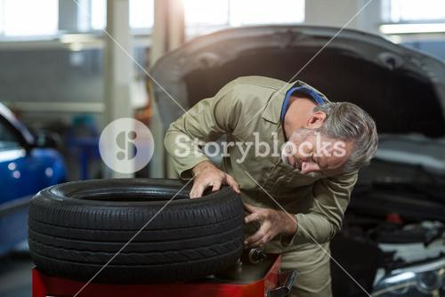 Mechanic examining a tyre