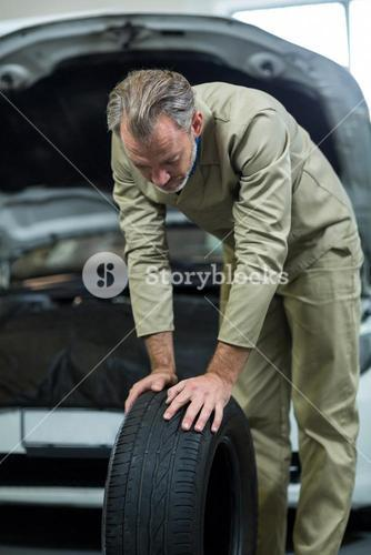 Mechanic looking at tyre
