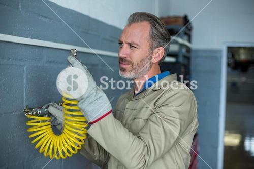 Mechanic installing a spring wire