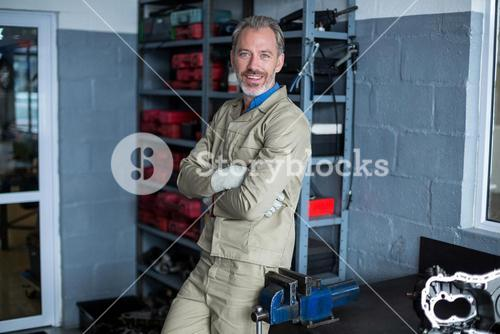 Mechanic standing with arms crossed