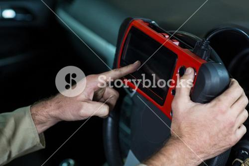 Mechanic using a diagnostic tool