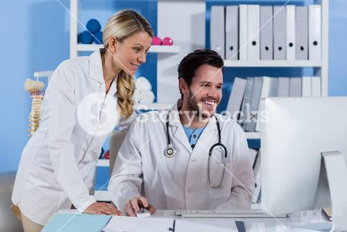Physiotherapist working on computer