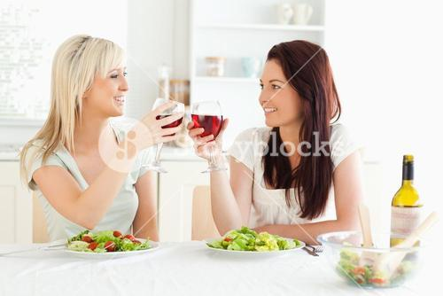 Smiling Women toasting with wine