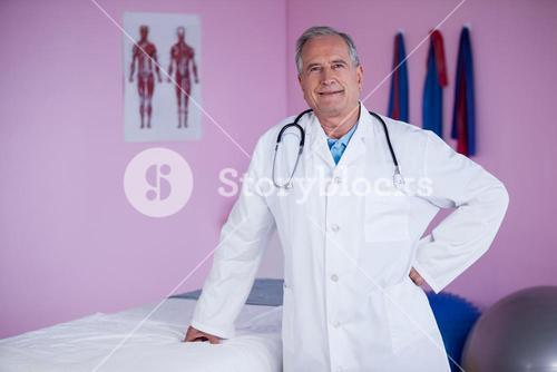 Portrait of physiotherapist standing with hands on hip