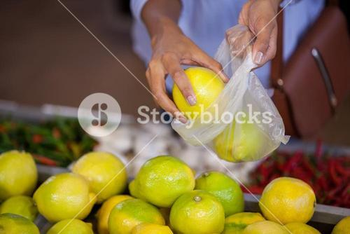 Woman buying sweet lime