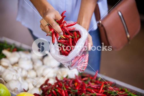 Woman buying red chilies