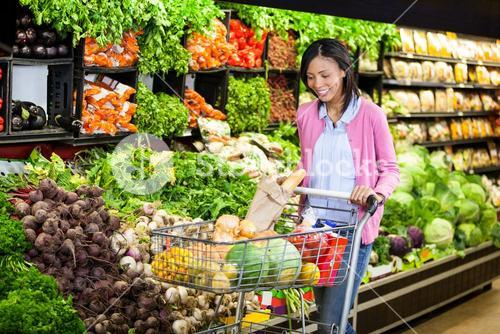Woman buying vegetables in organic section