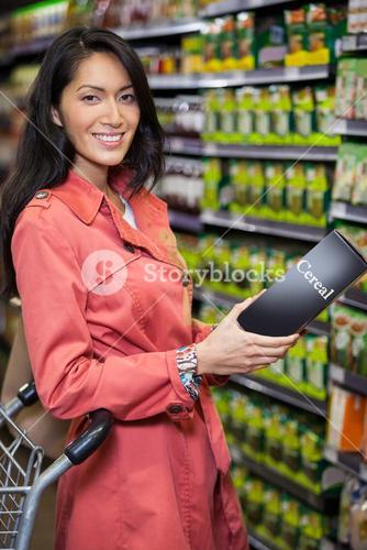 Woman buying cereals in grocery section