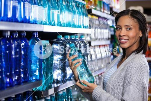 Woman buying a bottle of water