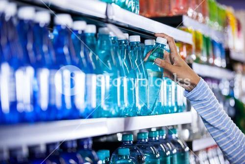 Woman picking a bottle of water