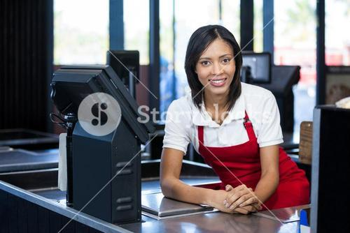 Female staff sitting at cash counter