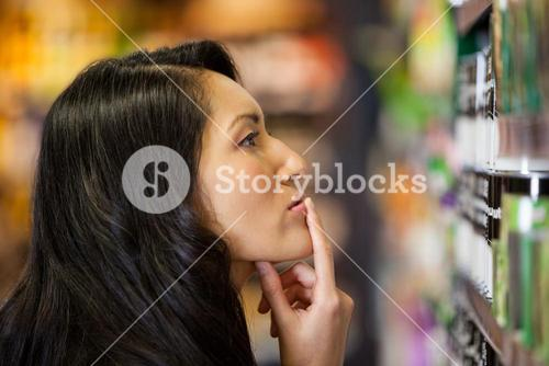 Thoughtful woman shopping for grocery