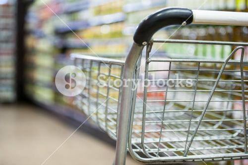 Empty shopping cart in grocery section