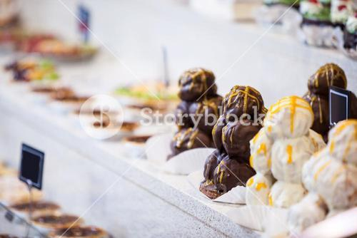 Close-up of desserts in display