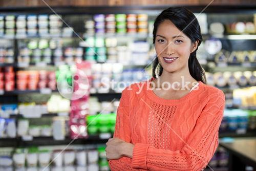 Portrait of woman standing in grocery section