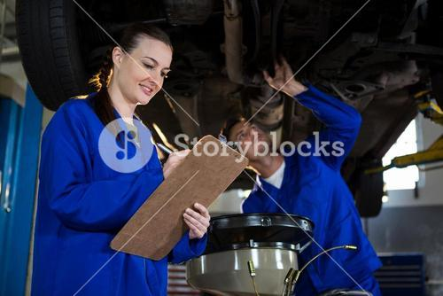Mechanics preparing a check list