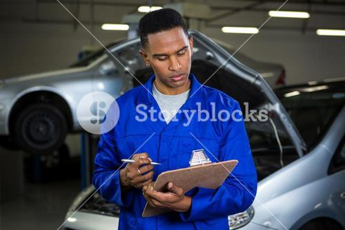 Mechanic preparing a check list