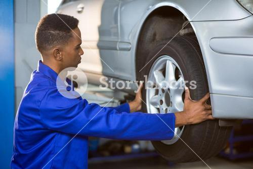 Mechanic fixing a car tyre