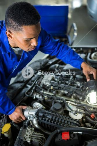 Mechanic examining car