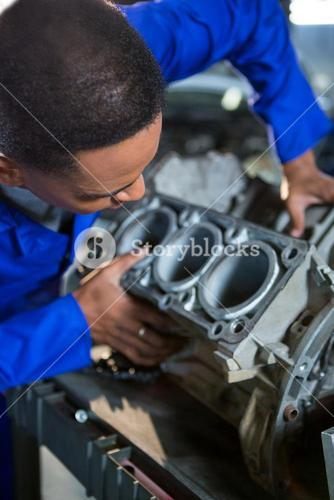 Mechanic examining a car parts