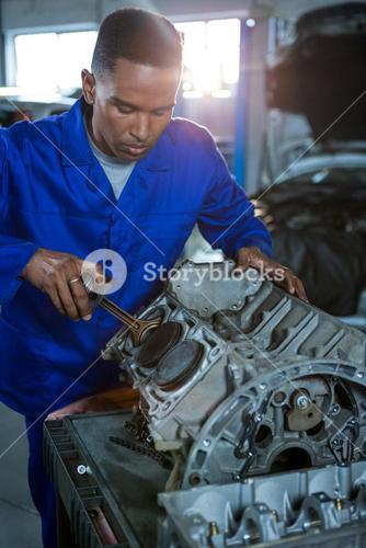 Mechanic repairing a car parts