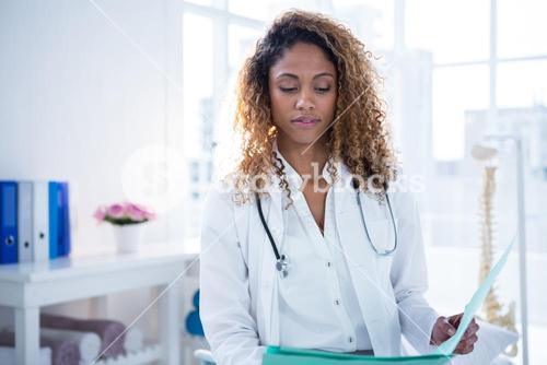 Physiotherapist holding clipboard