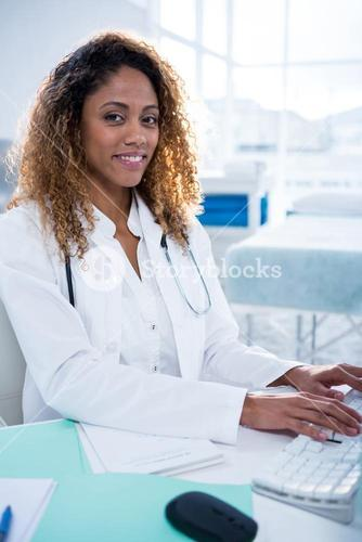 Portrait of physiotherapist working on computer