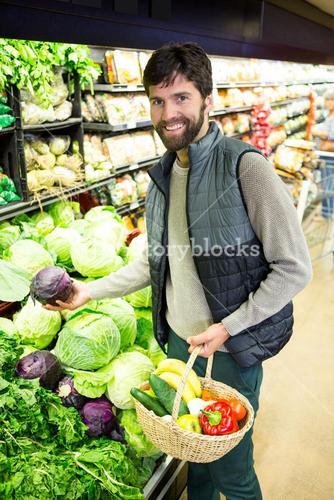 Portrait of man buying vegetables in organic shop