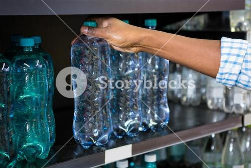 Man selecting a bottle of water