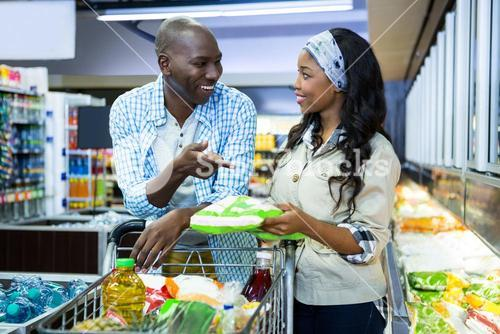 Smiling couple shopping in grocery section