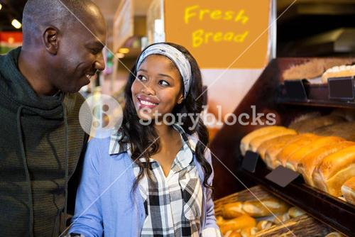 Couple at dessert counter in supermarket