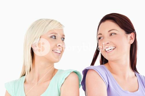 Laughing Friends standing back-to-back