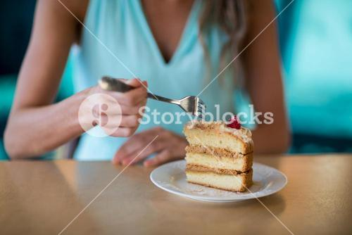 Woman eating dessert in cafe