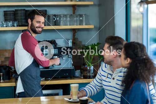 Customer interacting with waiter in café