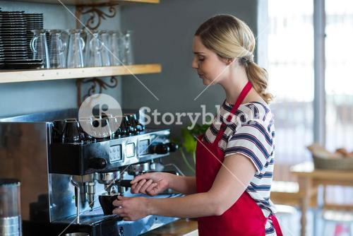 Waitress making cup of coffee
