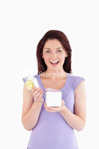 Cheering woman opening a box