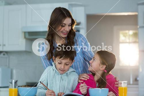Mother with son and daughter having breakfast